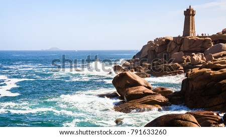 Shutterstock travel to France - lighthouse in Ploumanac'h site on rocky coast of English Channel with of Perros-Guirec commune on Pink Granite Coast of Cotes-d'Armor department of Brittany in sunny summer day