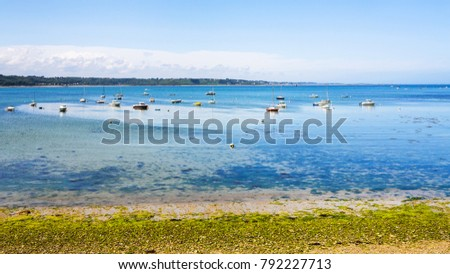 Shutterstock travel to France - marina in bay Anse de Perros of English Channel near Perros-Guirec commune on Pink Granite Coast of Cotes-d'Armor department in the north of Brittany in sunny summer day
