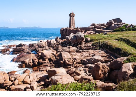 Shutterstock travel to France - Mean Ruz lighthouse in Ploumanac'h site on coast of English Channel in Perros-Guirec commune on Pink Granite Coast of Cotes-d'Armor department of Brittany in sunny summer day
