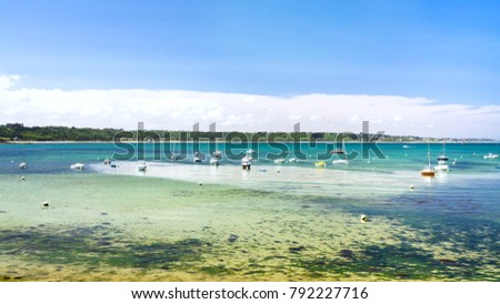 Shutterstock travel to France - ships in bay Anse de Perros of English Channel near Perros-Guirec commune on Pink Granite Coast of Cotes-d'Armor department in the north of Brittany in sunny summer day