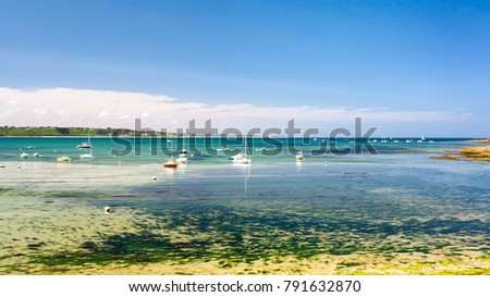 Shutterstock travel to France - view of bay Anse de Perros of English Channel near Perros-Guirec commune on Pink Granite Coast of Cotes-d'Armor department in the north of Brittany in sunny summer day