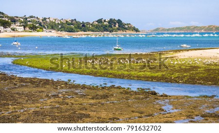 Shutterstock travel to France - view of Perros-Guirec town through estuary of river Kerduel and bay Anse de Perros in Cotes-d'Armor department in the north of Brittany in sunny summer day