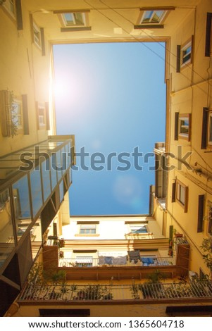 Travel to Italy bottom view of square sky from patio of urban house in Naples, sun ray in the sky. Сток-фото ©