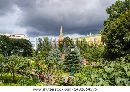 Travel to Moscow, Russia - view of green public Alexander Garden near Kremlin from Manege Square on summer overcast day #1482664595