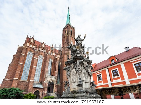 travel to Poland - John of Nepomuk ( St John Nepomucen) statue near Collegiate church of the Holy cross and St Bartholomew in Ostrow Tumski of Wroclaw city in Wroclaw city in september #751557187