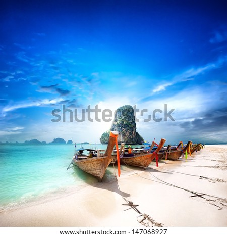 Stock Photo Travel to Thailand exotic destination landscape. Paradise island beach with boats. Beauty of thai tourism