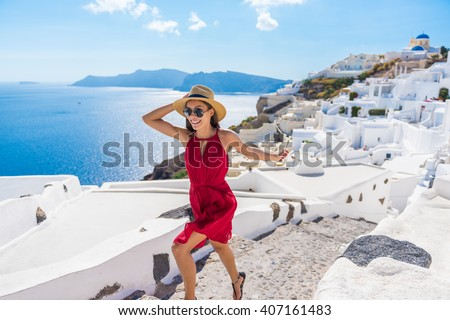 Travel Tourist Happy Woman Running Stairs Santorini, Greek Islands, Greece, Europe. Girl on summer vacation visiting famous tourist destination having fun smiling in Oia.  #407161483