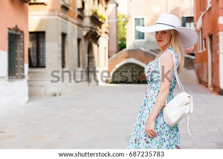 Travel tourist woman with backpack in Venice, Italy. girl on vacation smiling happy by Grand Canal. girl having fun traveling outdoors. - Shutterstock ID 687235783