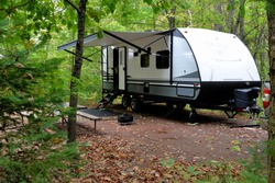 Travel trailer camping in the woods