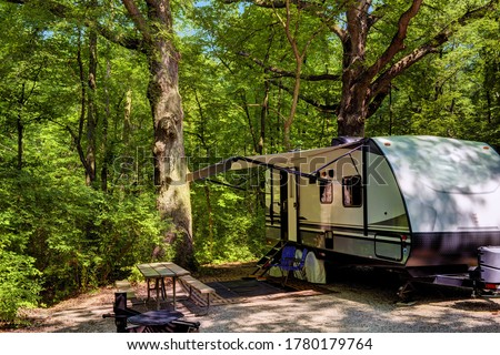 Travel trailer camping in the woods at starved rock state park illinois