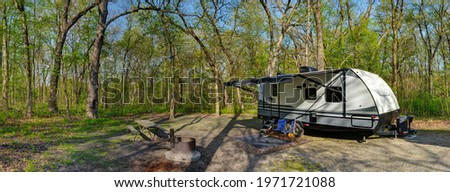 Travel trailer camping in the woods at starved rock state park illinois Stock photo ©