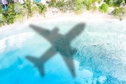 Travel traveling symbolic picture vacation sea airplane flying Seychelles beach waves