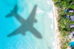 Travel traveling vacation sea symbolic picture airplane flying copyspace copy space Seychelles beach water image