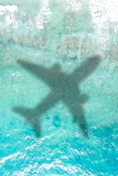 Travel traveling vacation sea symbolic picture airplane flying copyspace copy space Seychelles portrait format water image