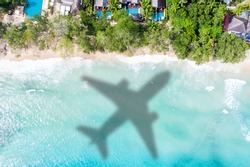 Travel traveling vacation sea symbolic picture airplane flying Seychelles beach water image