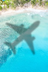 Travel traveling vacation sea symbolic picture airplane flying Seychelles portrait format beach water image