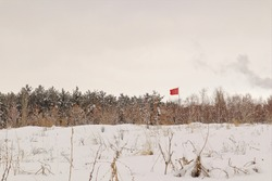 Travel turkey. Turkey flag appears flying in the middle of the forest in the winter in Erzurum. patriotism. The temperature in Erzurum could reach -50 ° C. Snow covered forest. Beautiful natural scene