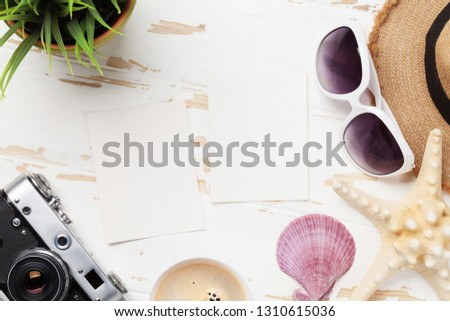 Travel vacation background concept with sun hat, camera, sunglasses and photo frames on wooden backdrop. Top view. Flat lay. All photos taken by me #1310615036
