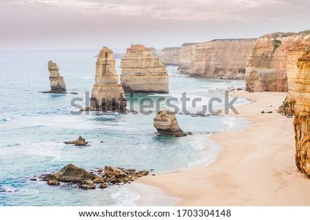 Travel Victoria, Australia, Great Ocean Road. Beautiful scenic landscape view of the tourist popular attraction twelve apostles, coastline of Tasman sea while sunset light. Stock photo ©