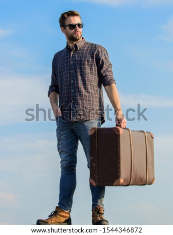 Travel with luggage. Travel blogger. Man carrying his things in baggage. Vacation time. Travel agency. Business trip. Handsome guy traveler. Guy outdoors with vintage suitcase. Luggage concept.