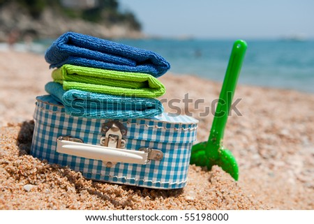 Travel with suitcase luggage and toys to the beach