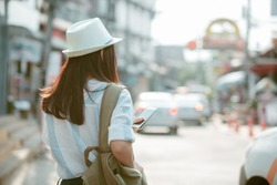 Travel woman with backpack and hat enjoy sunset. Close up of travel girl outdoors