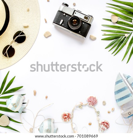 Traveler accessories, tropical palm leaf branches on white background with empty space for text. Travel vacation concept. Summer background. Road frame set. Flat lay, top view. #701089669