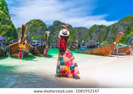 Traveler Asian woman in summer dress joy relaxing on natural sea beach, Maya beach, Phi Phi island, Krabi, Travel in Thailand, Beautiful destination place Asia, Summer holiday outdoor vacation trip