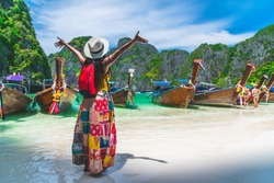 Traveler Asian woman in summer dress joy relaxing on sunny beach Maya bay Phi Phi island Krabi Travel Thailand fun beach, Tourism beautiful destination place Asia, Girl on summer holiday vacation trip