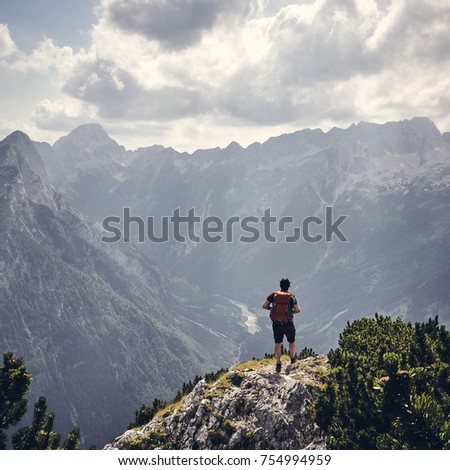 Traveler backpacker on mountains cliff hiking enjoy landscape Travel Lifestyle concept adventure active vacations outdoor aerial view - Shutterstock ID 754994959