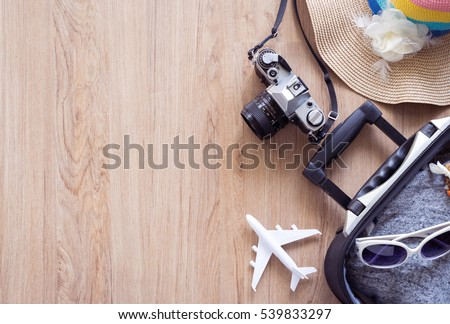 Traveler baggage and retro camera with copy space, Top view