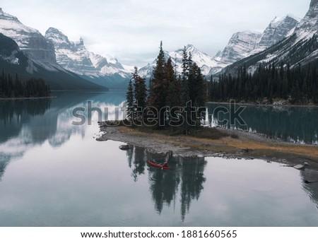 Traveler canoeing in Spirit Island on Maligne Lake at Jasper national park, Canada Stock photo ©