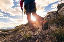 Traveler feet hiking in mountains