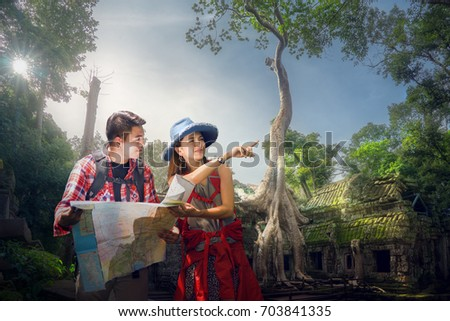 Traveler finding next camping point by a map, Ta prohm temple or Tom rider   is on Angkor wat temple area in Siem reap, Combodia, Asia, unesco, amazing, travel and temple concept