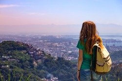 traveler girl with a backpack on the background Rio de Janeiro. Brazil