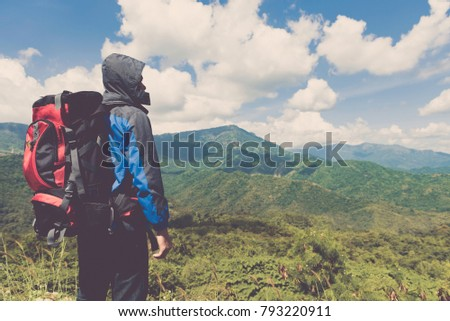 c1c48ec55c72 Traveler Man climbing with backpack Travel Lifestyle concept active adventure  summer vacations hiking outdoor mountains landscape