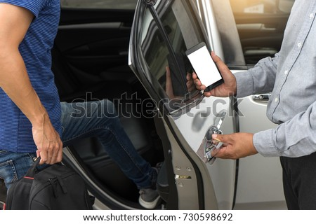 traveler or tourists go in to the car driver use smart phone from taxi  car sharing with white mobile phone screen with  clipping path