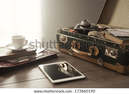 traveler's suitcase with...