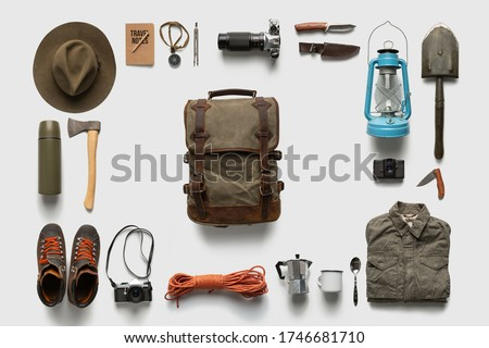 Traveler set on white background isolated. Packing backpack for a trip creative concept. Foto stock ©