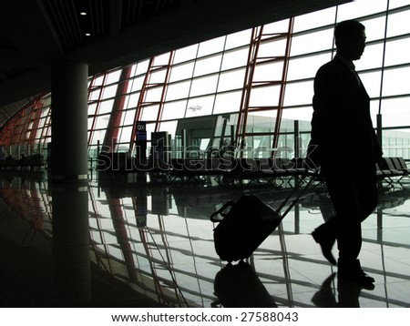 traveler silhouettes at airport
