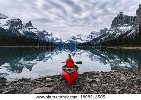 Photo of  Traveler sitting with paddle on canoe in Maligne lake at Spirit Island, Jasper national park, Canada
