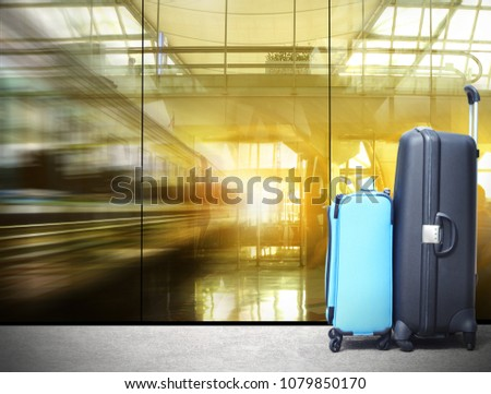 traveler suitcases in airport terminal waiting area,  interior with large windows, focus on bag,summer vacation concept, airplane in background,