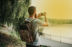 Traveler / tourist taking a photo at sunset.