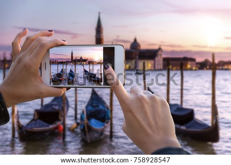 Traveler tourist taking beautiful landscape photo of european sunset during holiday vacation