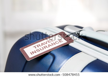 traveler travel insurance tag bag safe suitcase journey concept - stock image #508478455