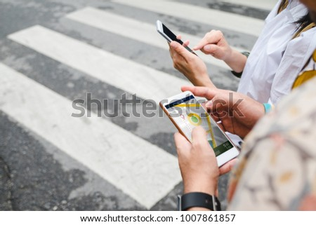 Traveler use map on mobile phone app to search for route location of place with gps on street when travel in city,Technology in lifestyle  #1007861857
