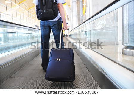 Traveler with a suitcase on the speedwalk #100639087