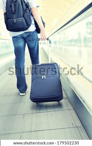 Traveler with a suitcase on the speedwalk #179502230