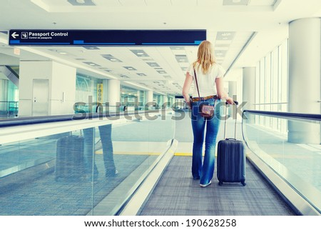 Traveler with a suitcase on the speedwalk #190628258