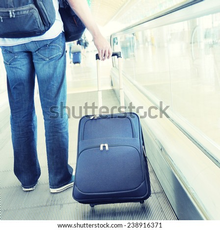 Traveler with a suitcase on the speedwalk #238916371